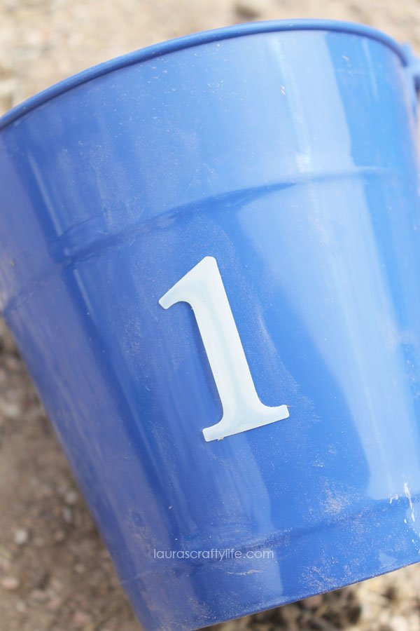 Use scrapbooking stickers to label buckets with numbers for games
