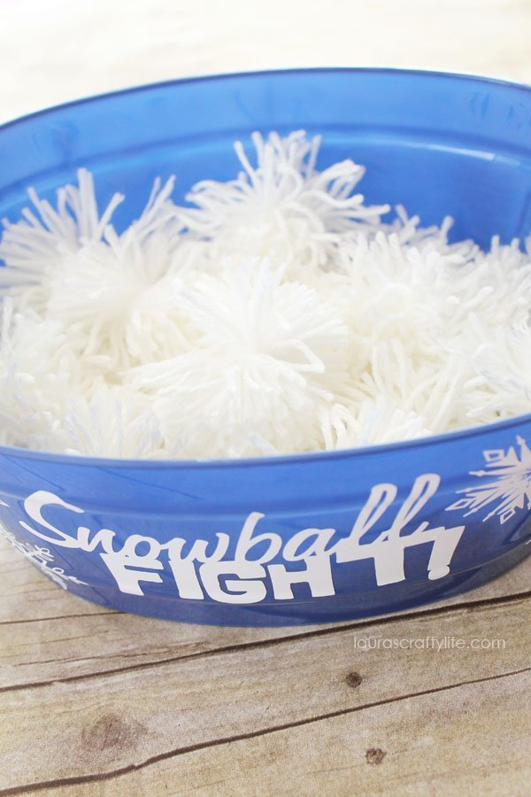 White yarn pom pom snowballs for Snowball Fight Frozen party game