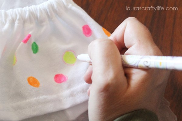 Use fine tip side of Tulip fabric markers to create detail