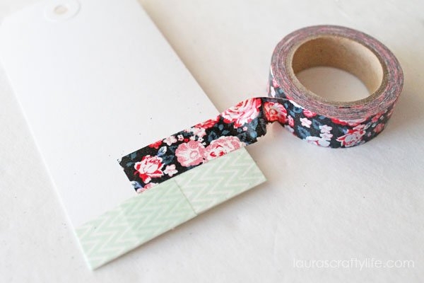 Wrap washi tape around tags