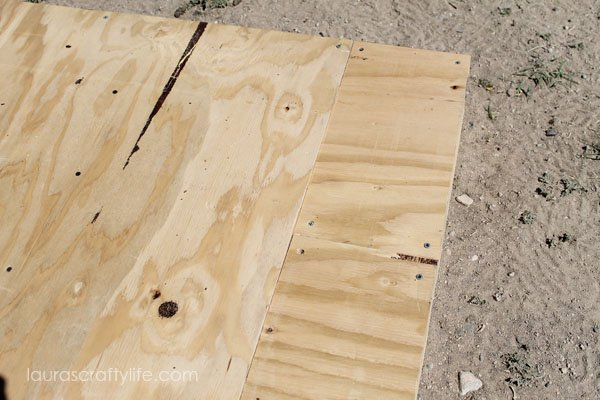 Close up of pieced together plywood for chicken coop roof