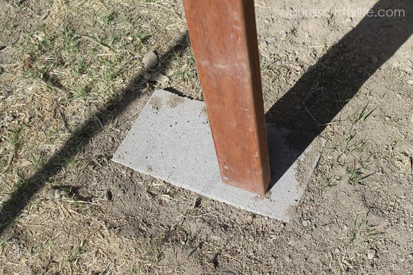 Use concrete pavers to create a level base for chicken coop and to prevent the wood from touching earth