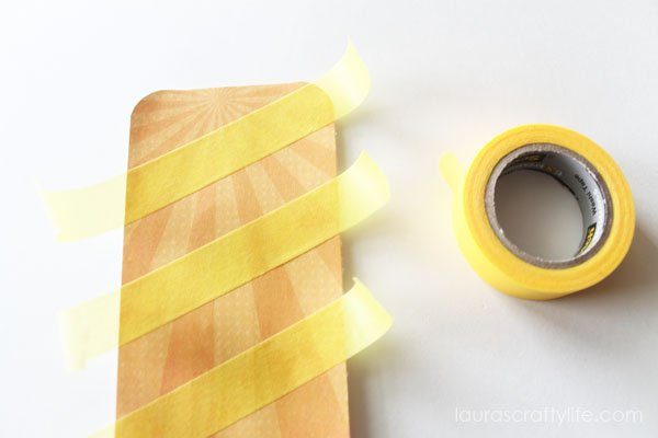 Add Scotch® Brand washi tape to popsicle shape