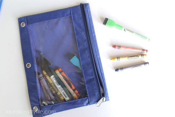 Pencil pouch with crayons and dry erase markers