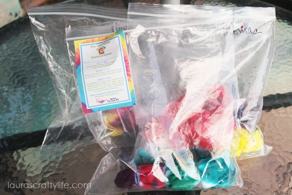 Place completed tie dye projects in gallon size plastic bags