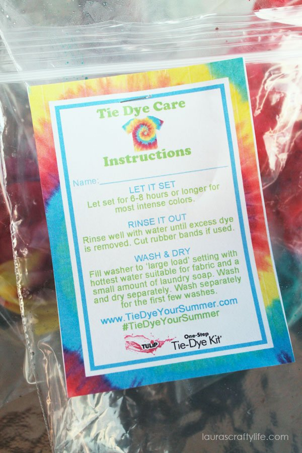 Staple instructions for washing tie dye to plastic bag