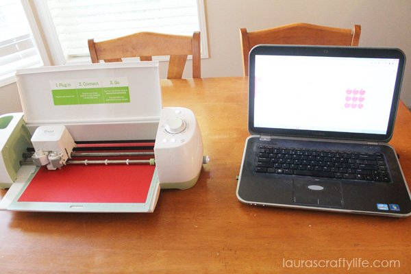 Use Cricut Explore to cut apple shapes and letters