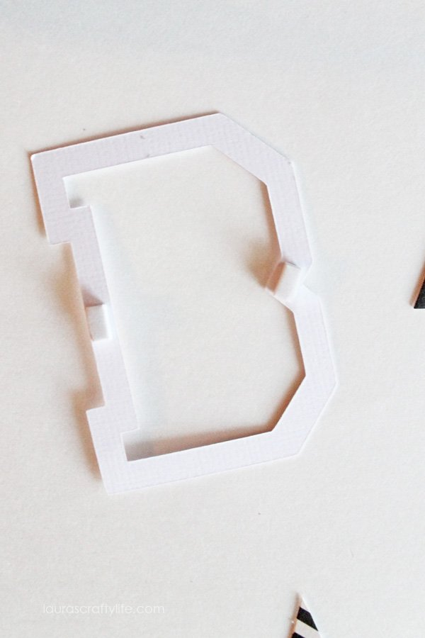 Use adhesive squares to attach letters to apples