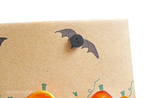 Glue button on bat shape