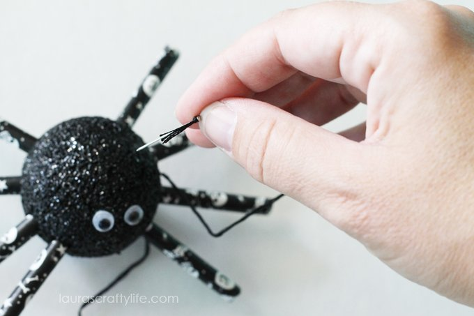 Use a pin and embroidery floss to hang spider