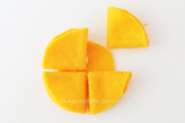 Use hot glue to attach triangles to base felt circle