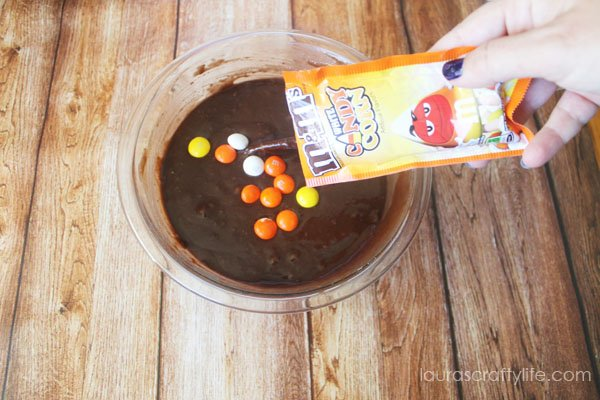 Add candy corn M&Ms to brownie batter