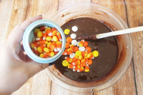 Add mini candy corn pieces to brownie batter