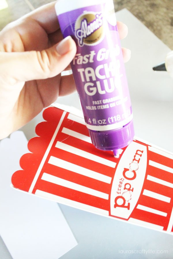 Glue cardstock to popcorn box