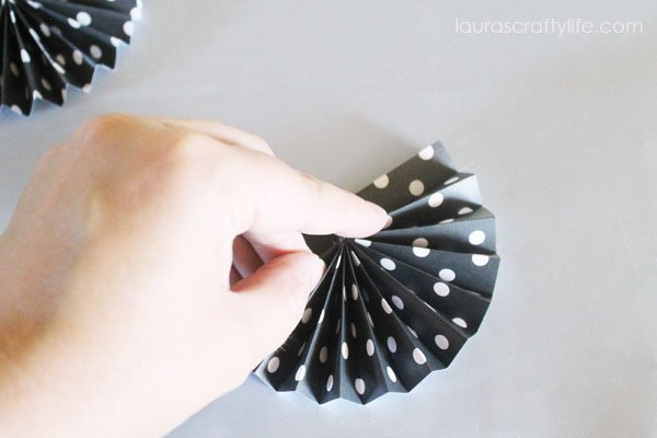 Hold accordian fan shape together for about 10 seconds
