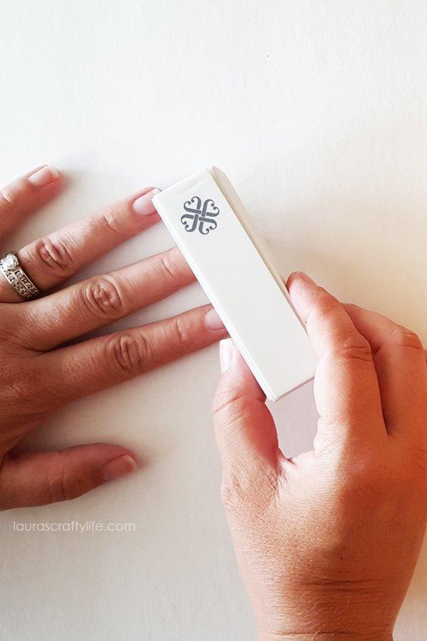 Lightly buff shine off nails