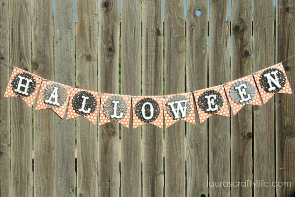 October Halloween Banner made with the We R Memory Keepers Banner Punch Board and Pebbles, Inc