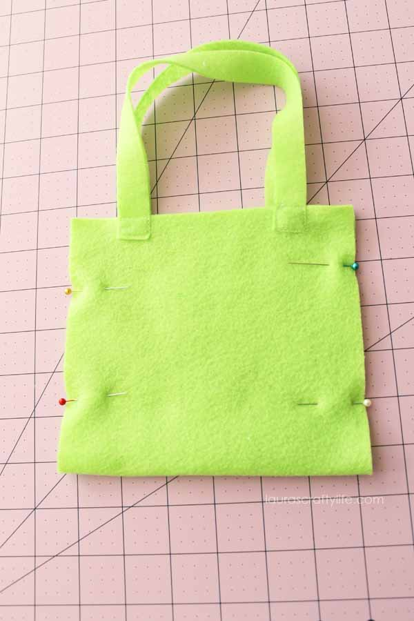 Pin sides of bag together
