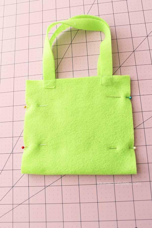 Pin sides of bag together