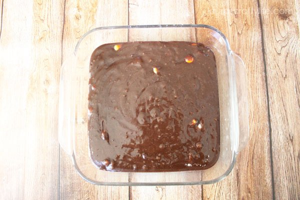 Pour brownie batter into baking dish