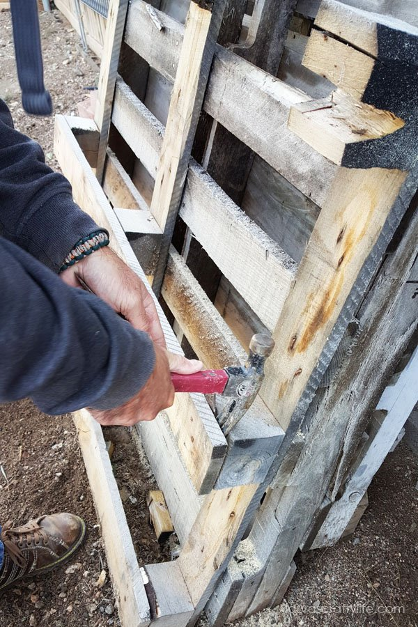 Use a hammer to slightly loosen nails from pallet