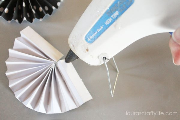 Use glue gun to glue two have accordian shapes together