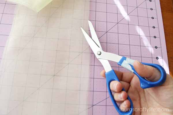 Use scissors to trim folded edge of tulle
