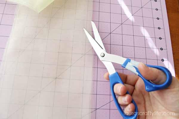 Use scissors to trim folded edge of tulle