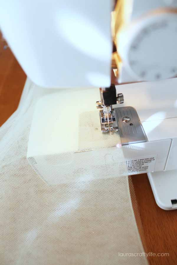Use sewing machine to baste tulle