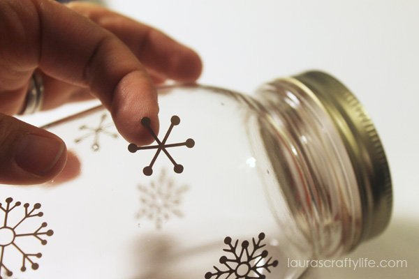 Apply vinyl snowflakes to jar