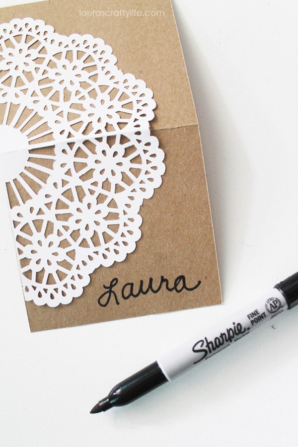 Write guest's name on place card with Sharpie
