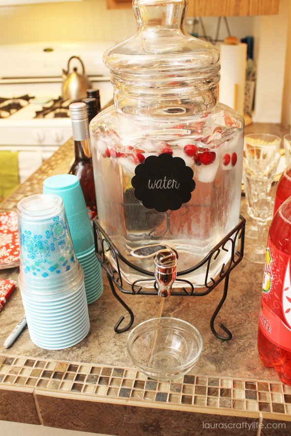 Add cranberries to ice cubes to create a festive water station