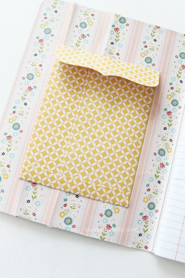 Attach envelope to inside of notebook