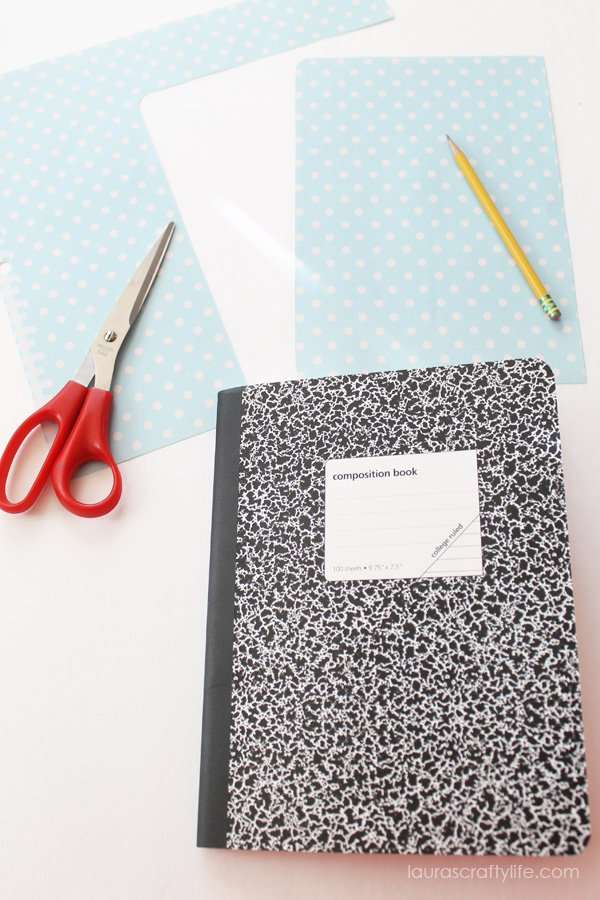 Use composition book as a guide to trace paper for front cover