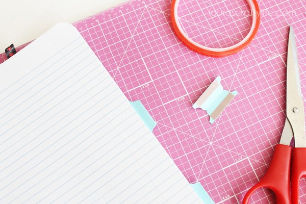 Use tacky tape to adhere label tabs to notebooks