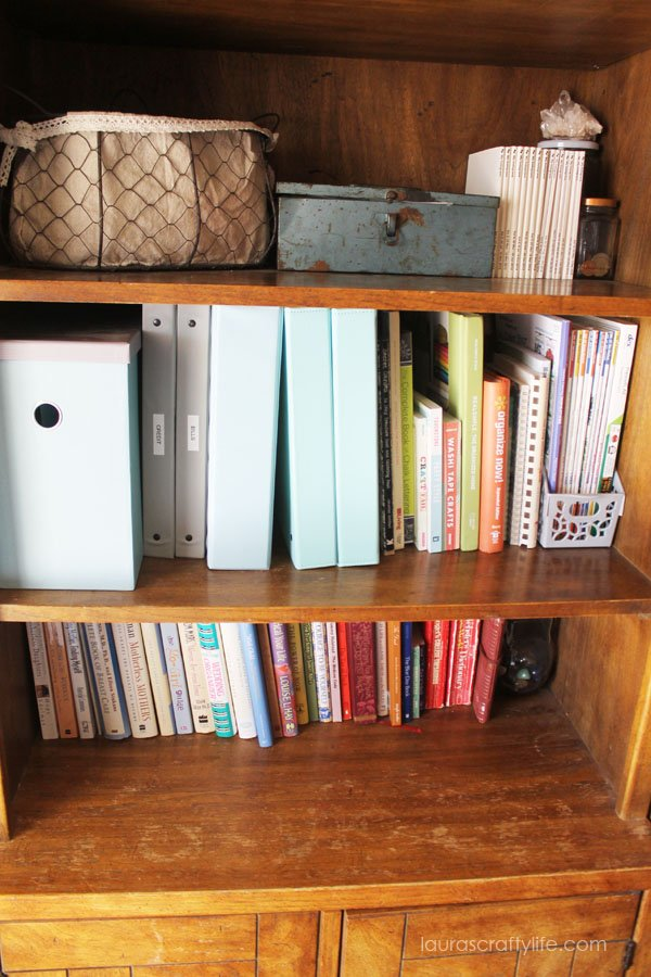 bookshelf with home management binder