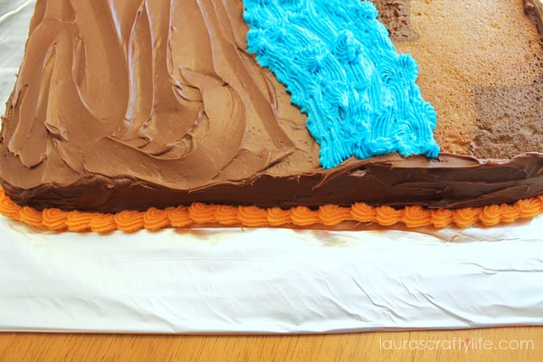 Pipe around the bottom of the cake using hunter orange icing