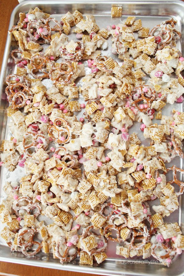 Spread trail mix on baking sheet to cool