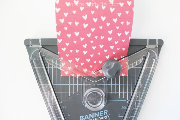 Use banner punch board to cut a crest shape banner