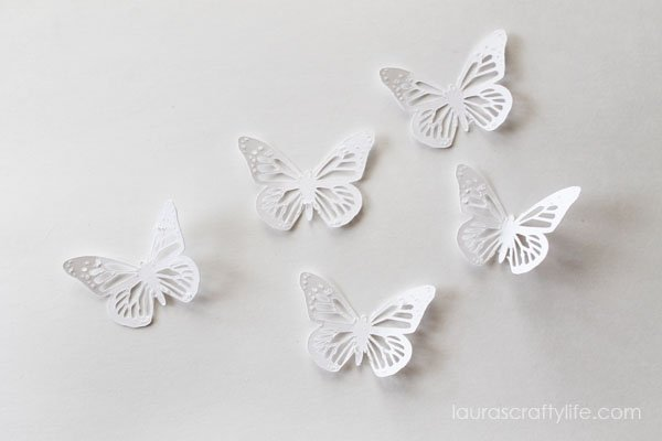 Cut out butterfly shapes using the Cricut Explore
