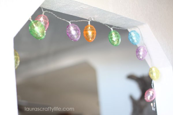 Colorful Easter egg garland hanging over archway
