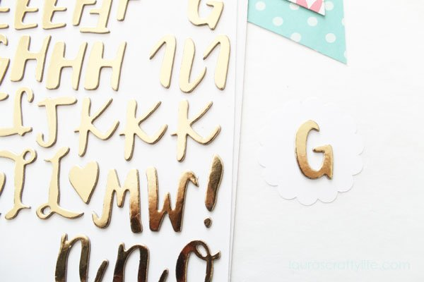 Use a 2 inch scallop punch to cut circle and attach Thicker letter