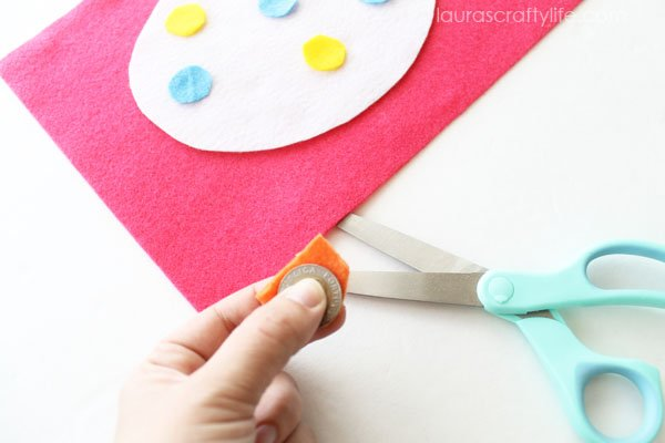 Use a coin as a guide to cut out circles out of felt