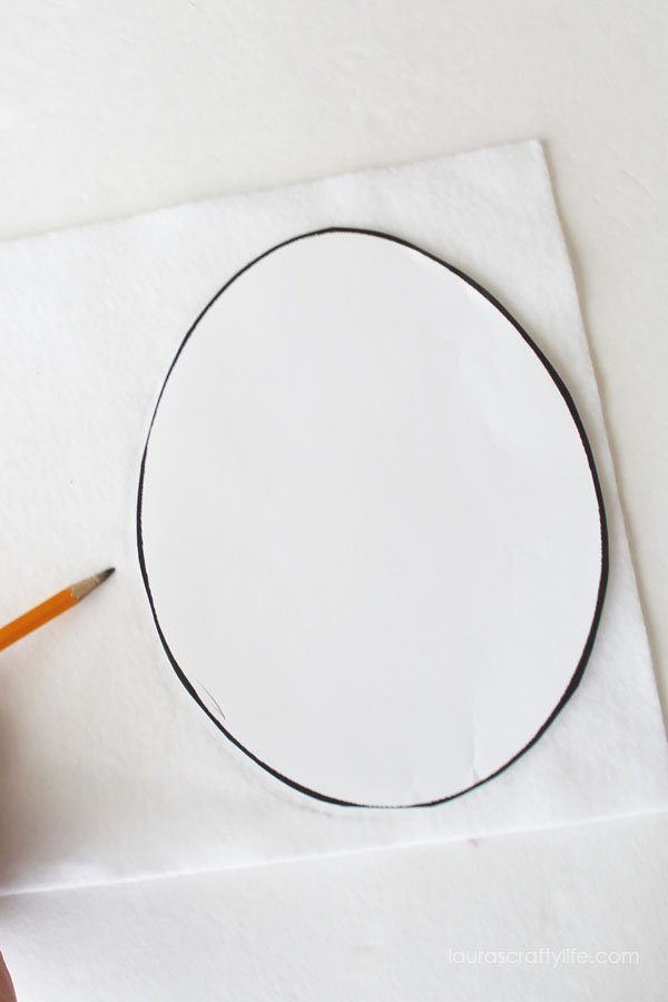Use a egg shape to trace onto white felt