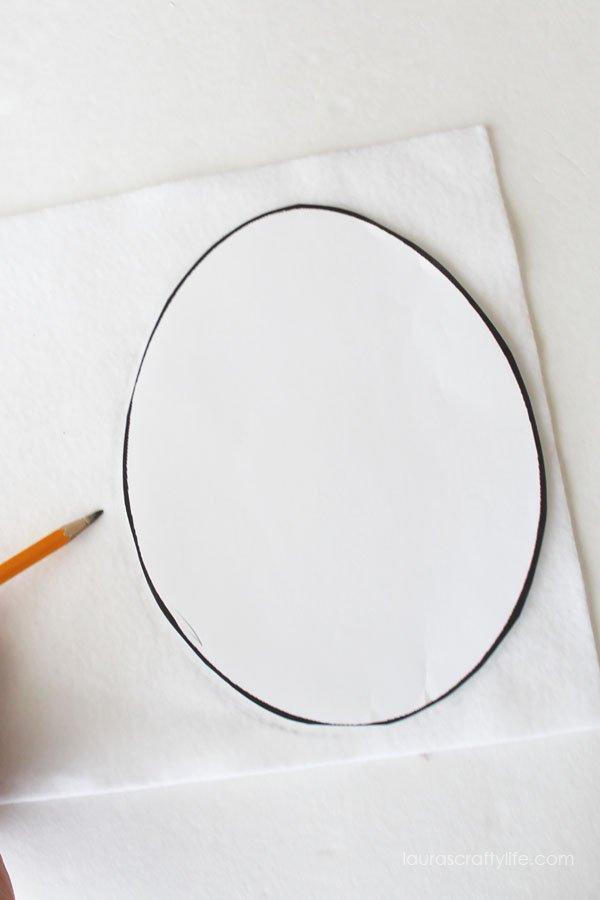 Use a egg shape to trace onto white felt