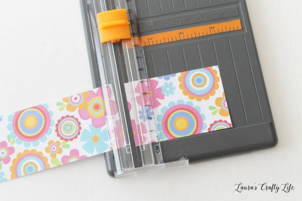 Trim paper to 2 inches by 3 inches