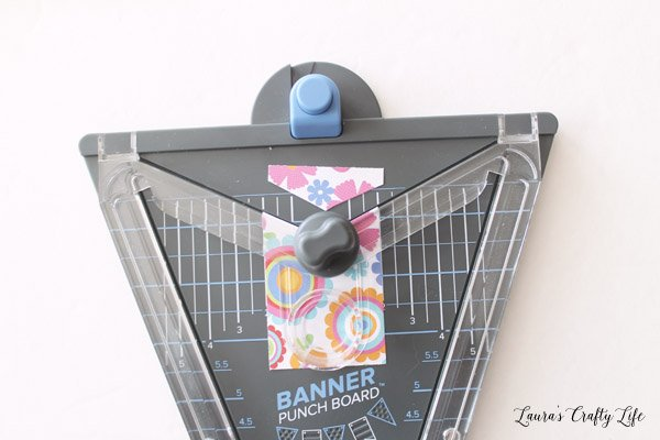 Use We R Memory Keepers banner punch board to create flag