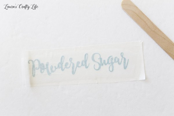 Use transfer tape to move vinyl from paper backing to project