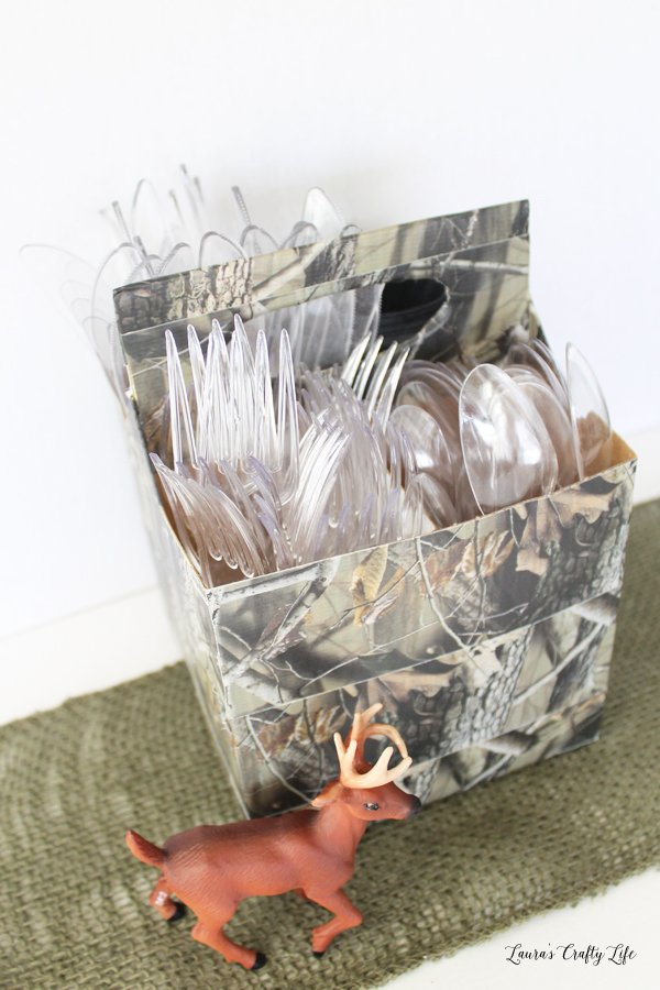 Make a utensil caddy with duck tape and a cardboard drink holder