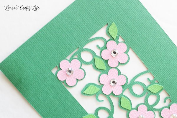 Rhinestones on paper flowers